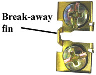 Break-away fin on electric device
