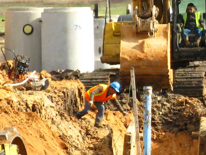 Men doing sewer construction