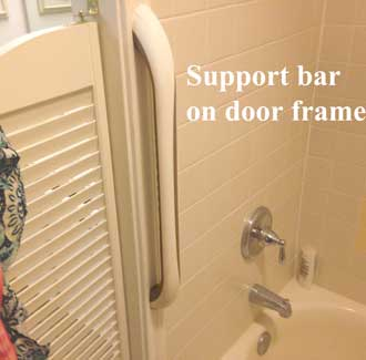 Support bar on door frame